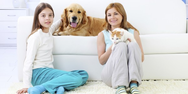 Mother and daughter enjoy the society of their pets.